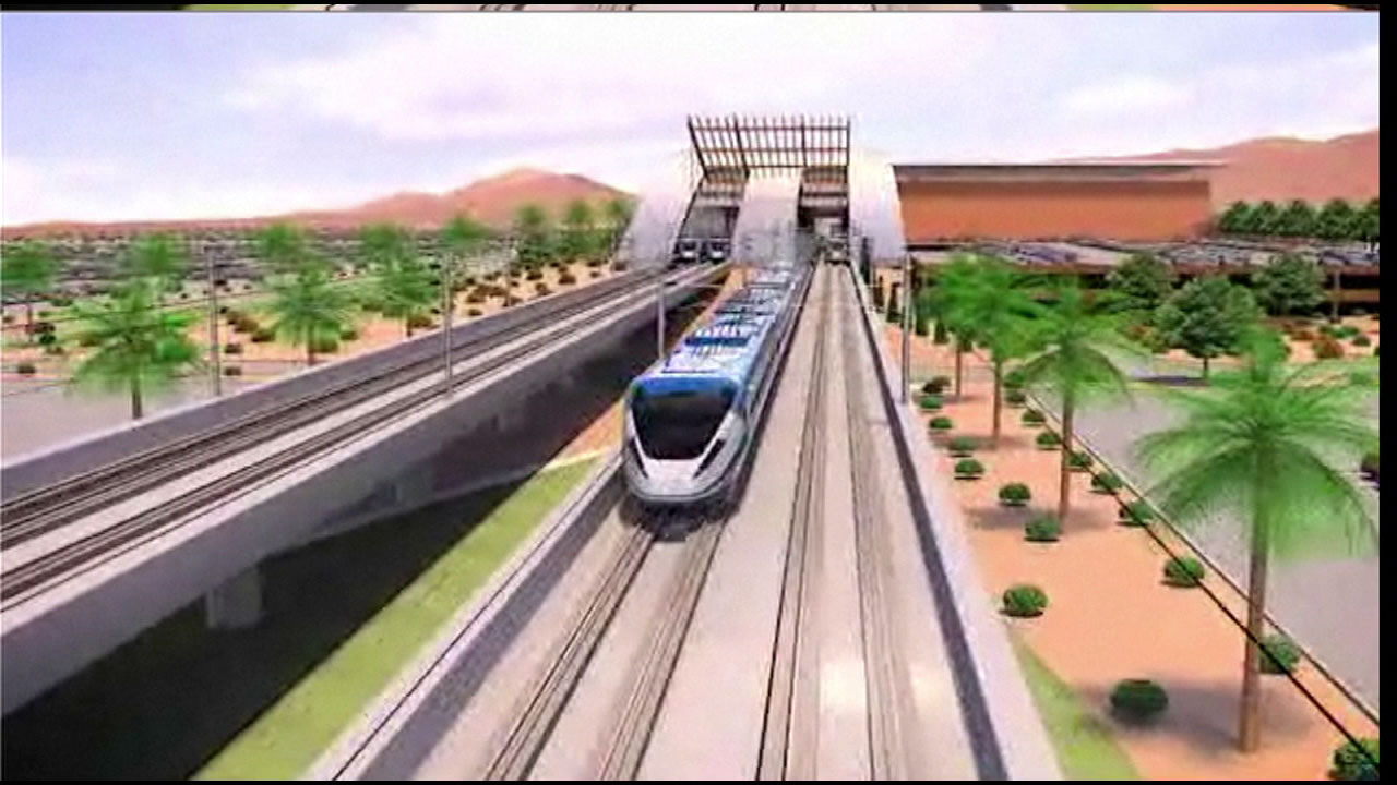 A rendering shows a train and rail system between the Southland and Las Vegas.
