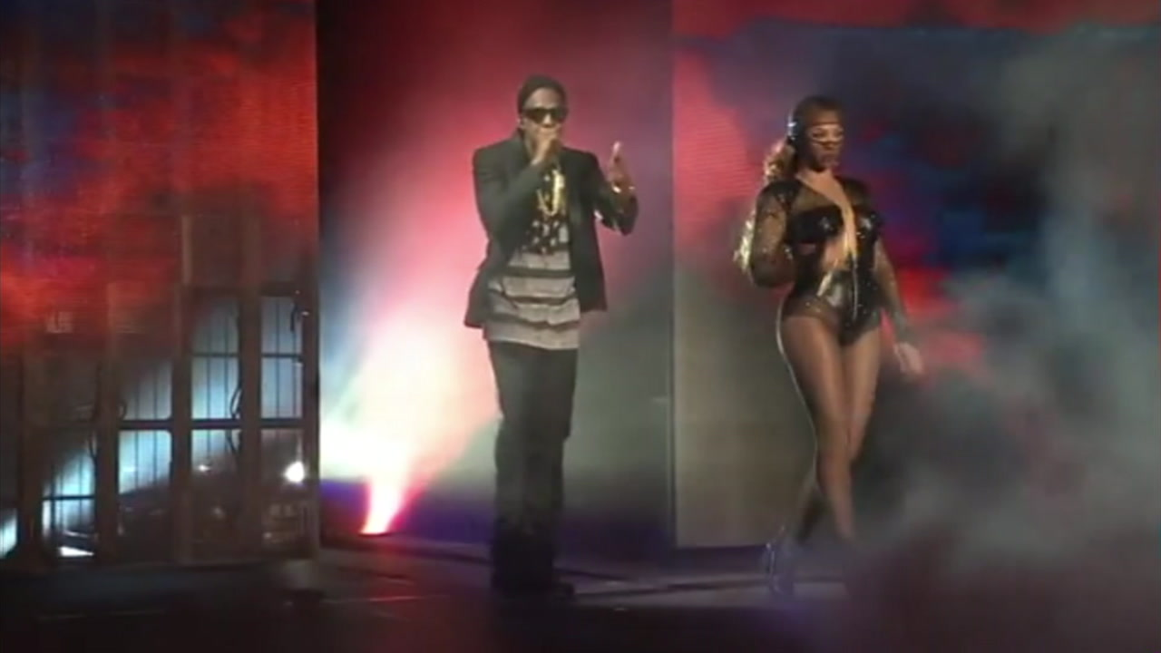 Beyonce and Jay Z are shown onstage at the Pasadena Rose Bowl during their On The Run 2 tour.