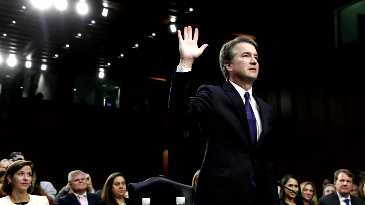 U.S. Supreme Court nominee Brett Kavanaugh is shown swearing under oath during one of his confirmation hearings.