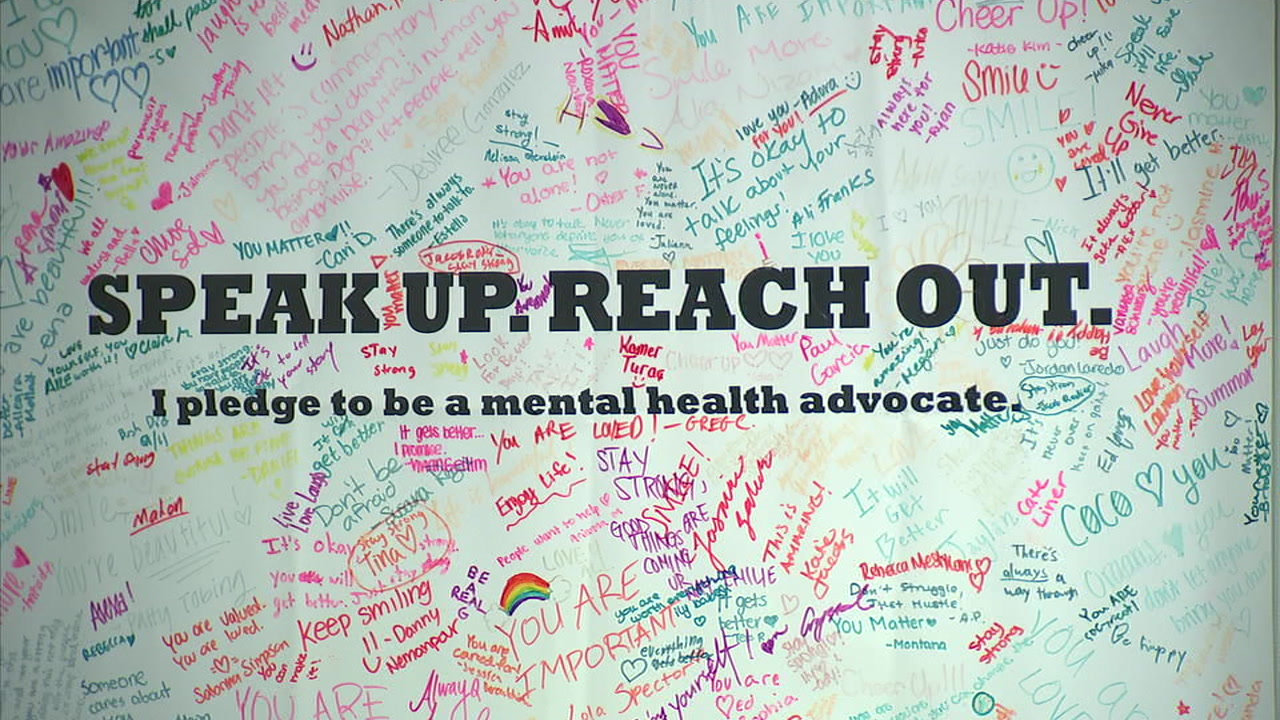 Positive messages are written on a board as part of a suicide prevention program at Beverly Hills High School.