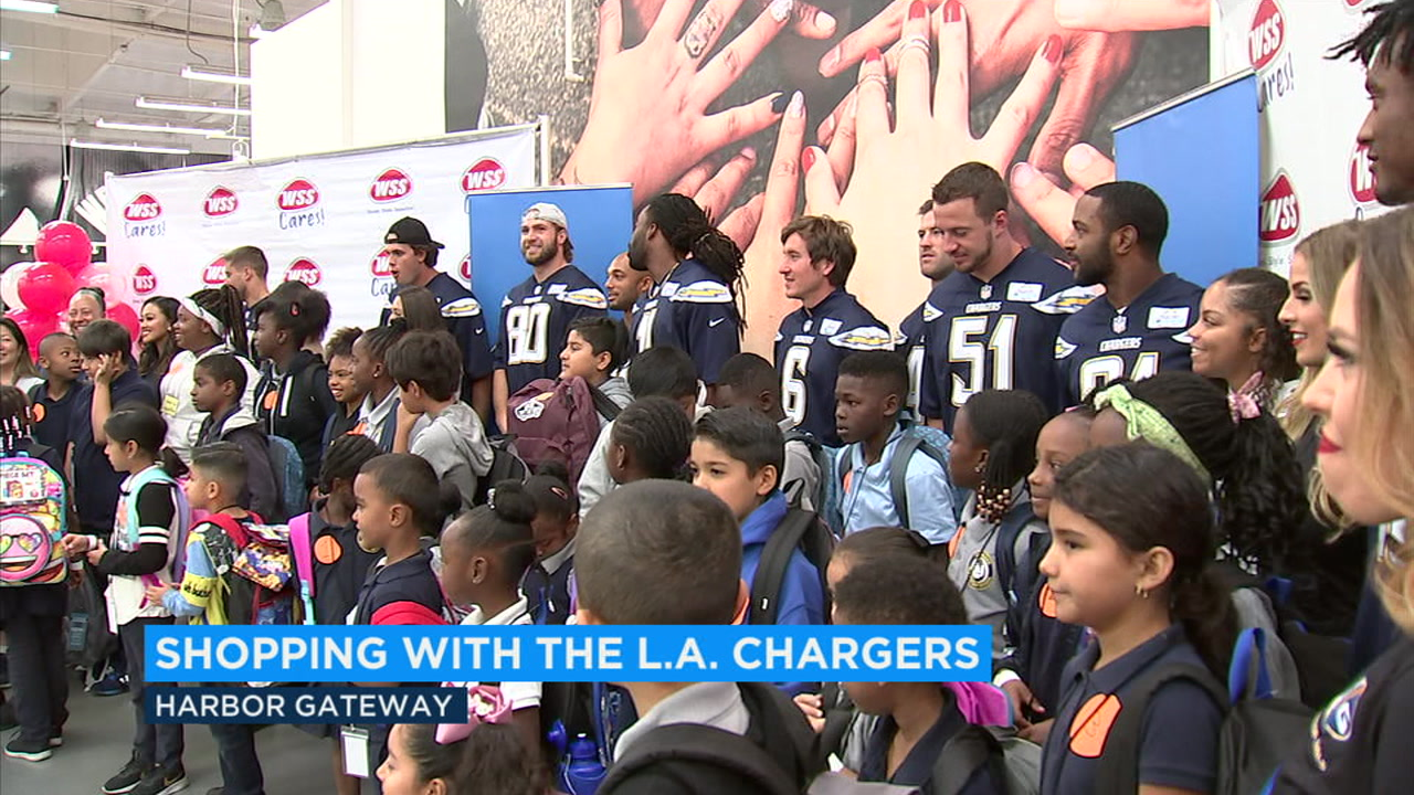The Los Angeles Chargers posed with Inglewood students as they helped them shop for new shoes and backpacks.