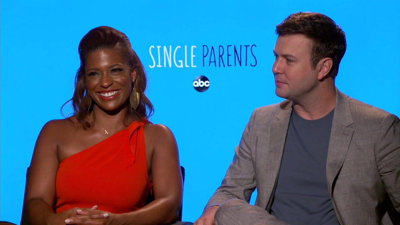 Kimrie Lewis and Taran Killam are shown during an interview for their new ABC show Single Parents.