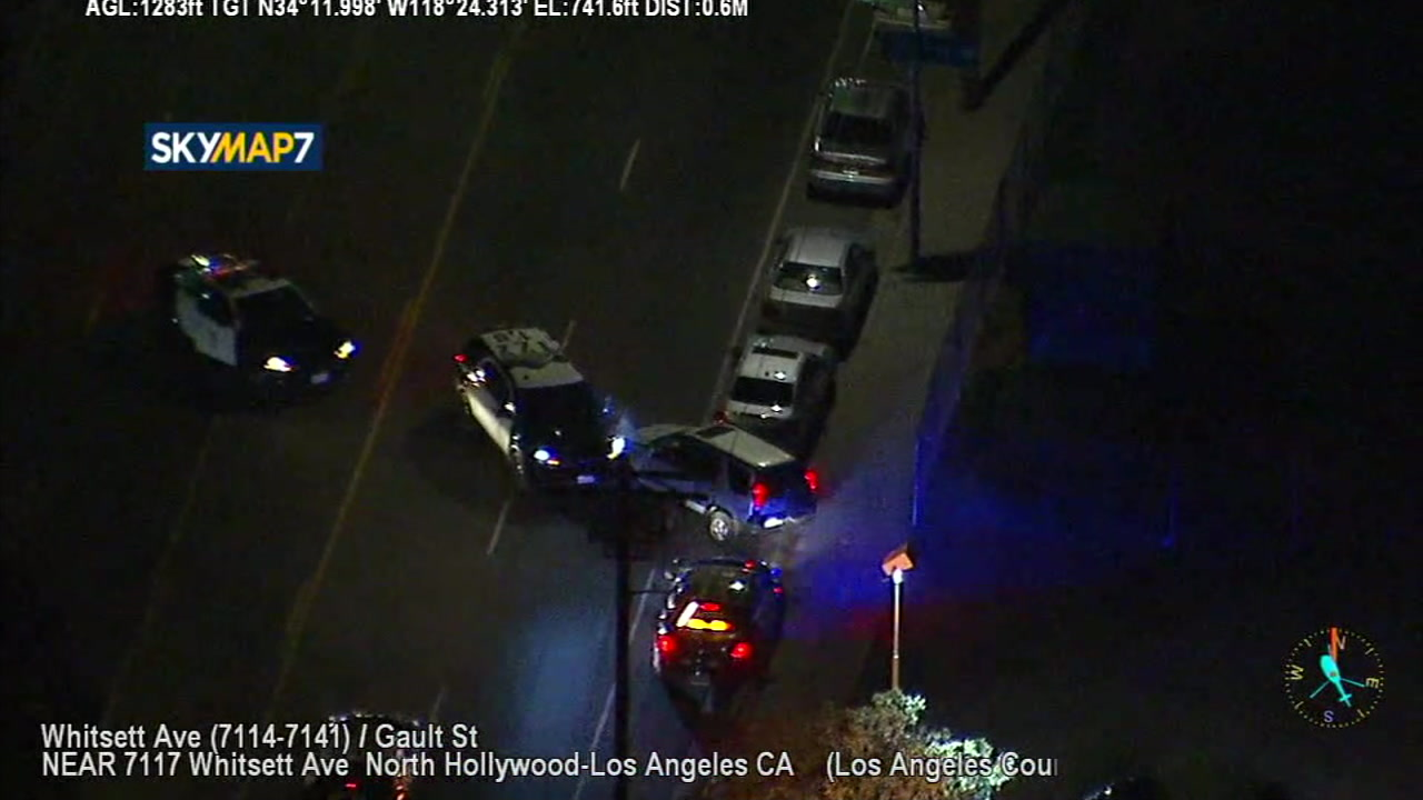 A police SUV rams into the front of a stolen vehicle after the driver was carjacked by a chase suspect in North Hollywood.