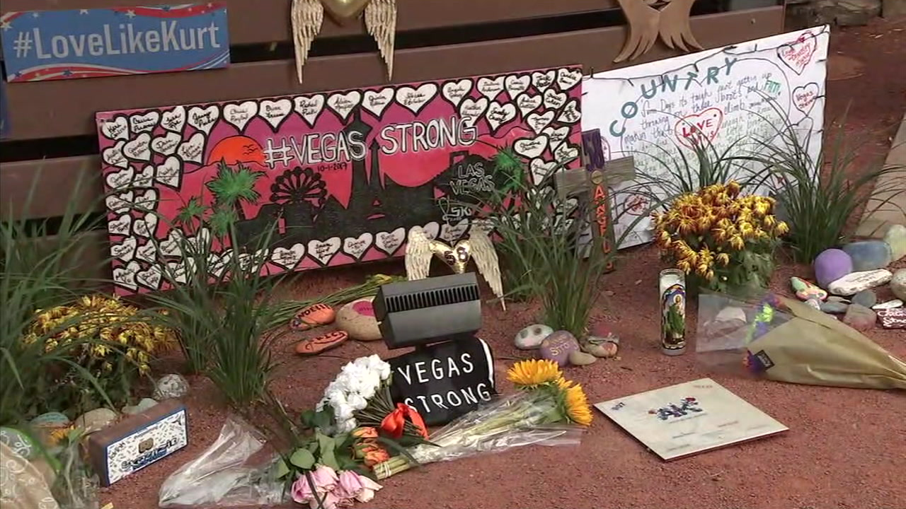 Signs and mementos were left at the Las Vegas Healing Garden on the one-year anniversary of the mass shooting.