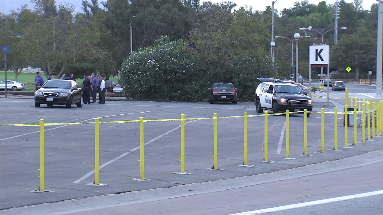 Investigators gather at a parking lot near the Rose Bowl in Pasadena.
