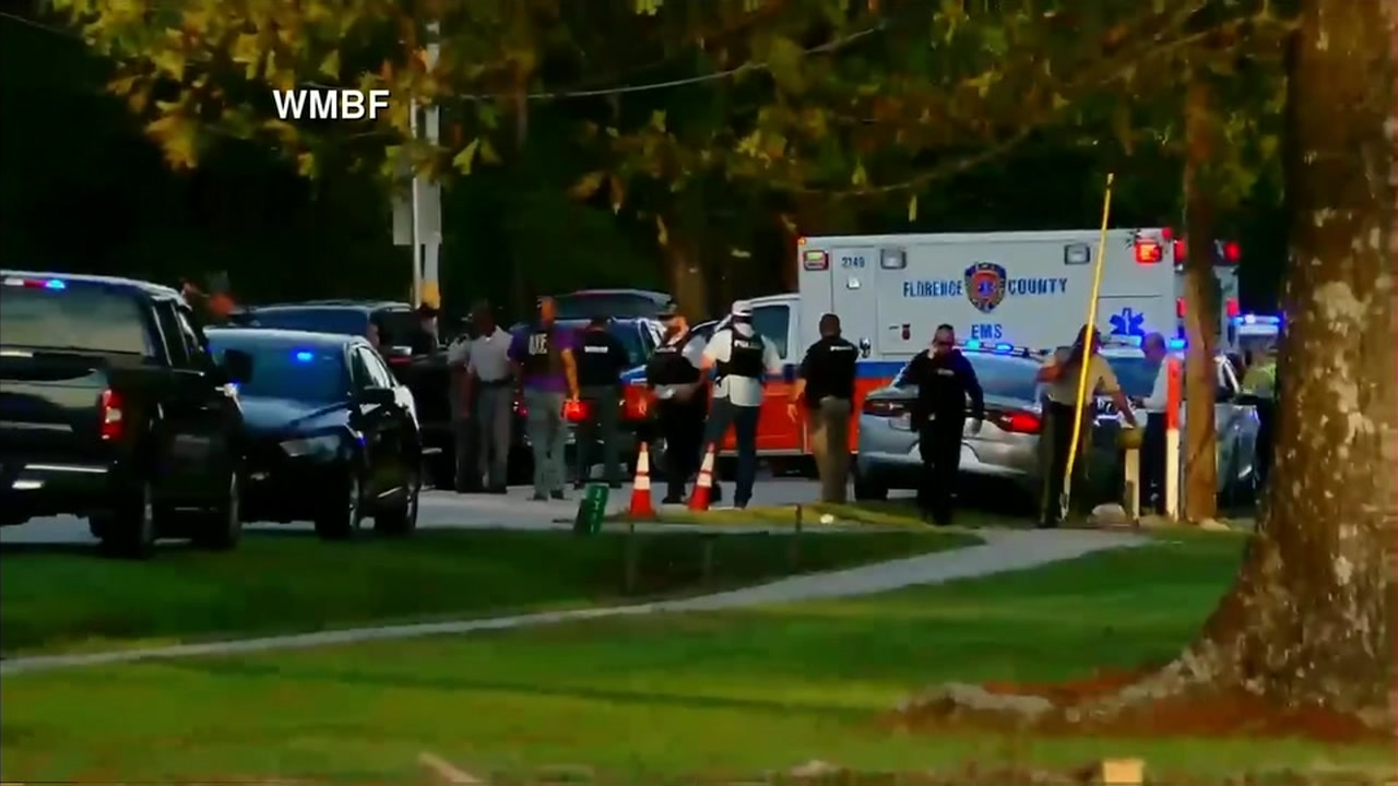 Authorities say a suspect is in custody after seven South Carolina law enforcement officers were shot in Florence County.
