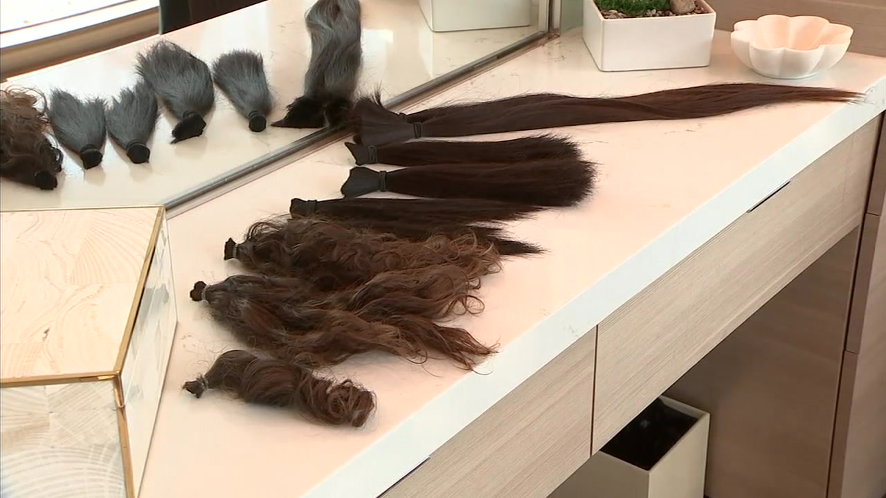 Ponytails of donated hair are shown on a counter in Spa Pechanga.