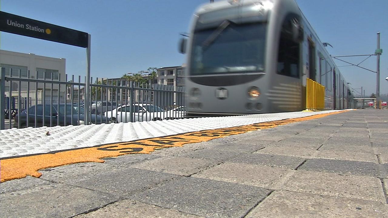 A Metro rail train is shown in a photo.