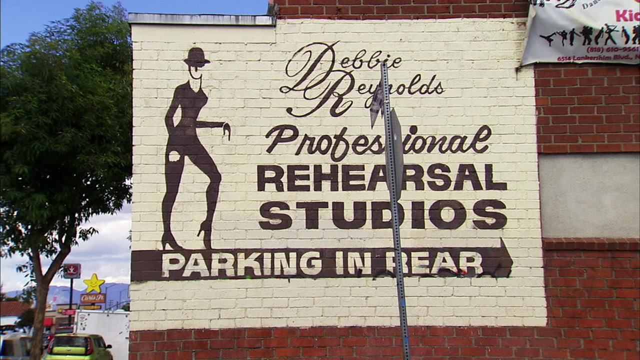 A sign for Debbie Reynolds Legacy Studios is shown on the side of a building in North Hollywood.