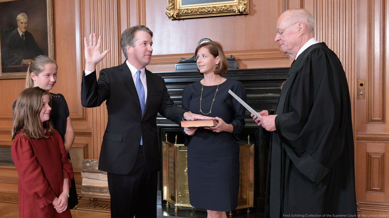 Retired Justice Anthony M. Kennedy, right, administers the Judicial Oath to Judge Brett Kavanaugh in the Justices Conference Room of the Supreme Court Building on Oct. 6, 2018.
