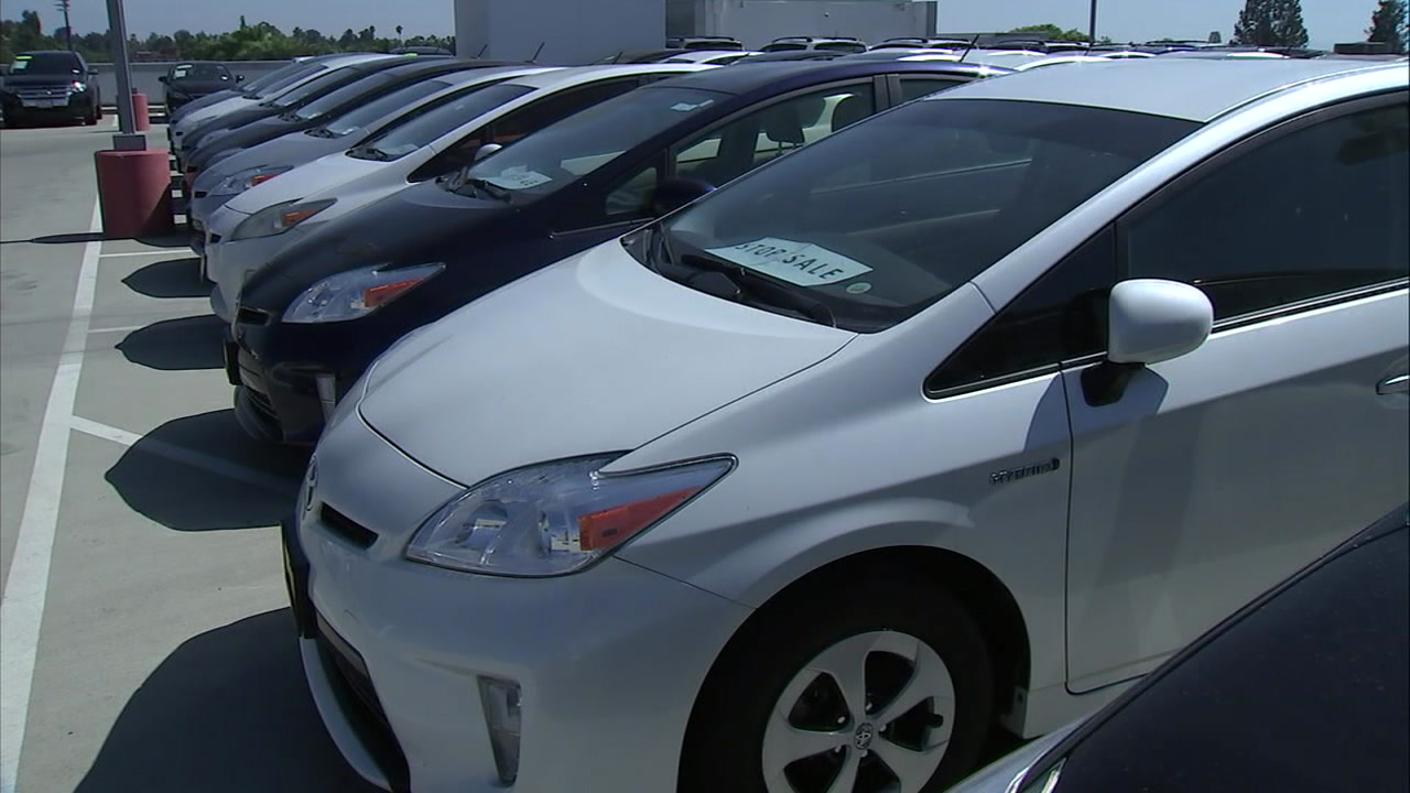 Toyota Prius models that are not for sale are shown on the lot of a Claremont dealership.