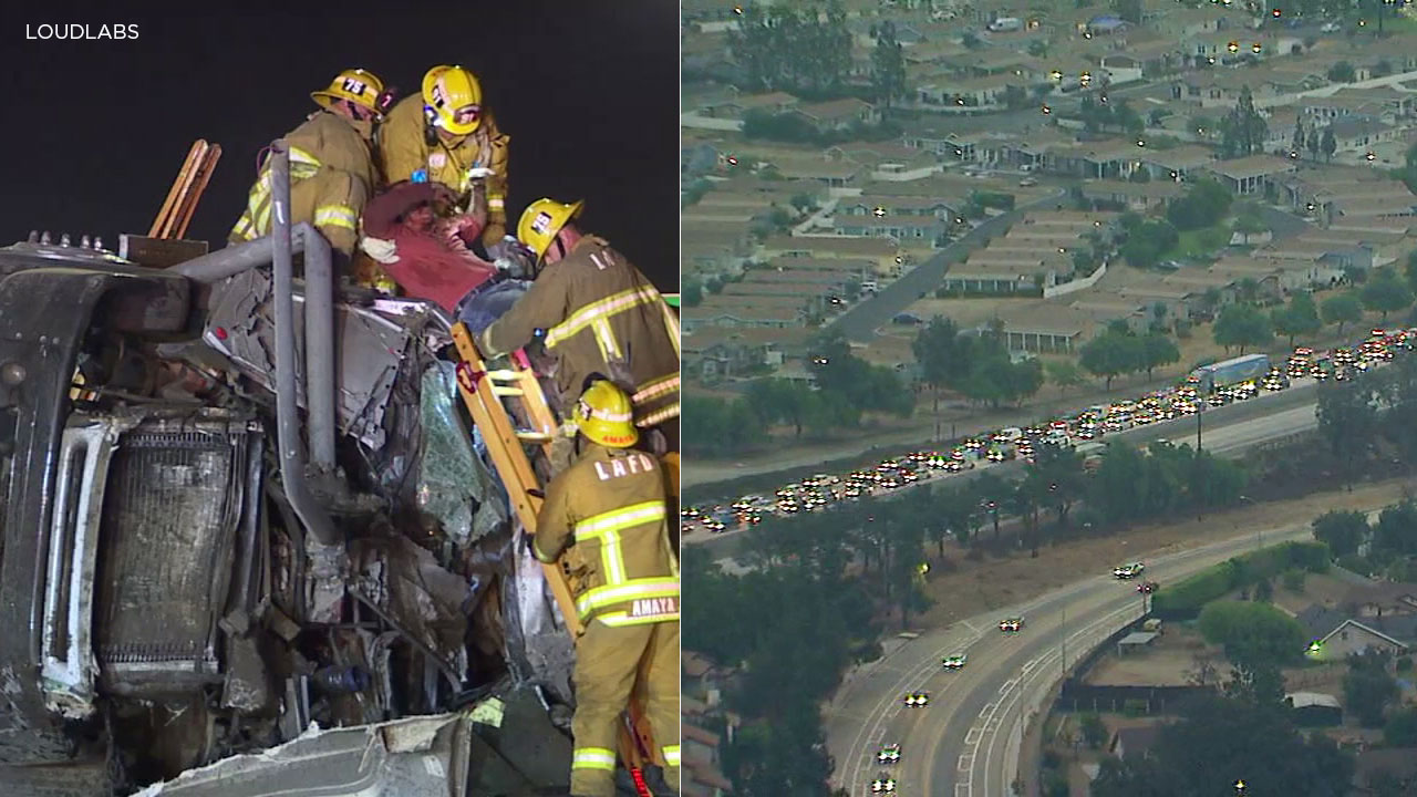 A tanker truck driver is pulled from a wreckage on the 210 Freeway in Sylmar that caused a major backup on Tuesday, Oct. 9, 2018.