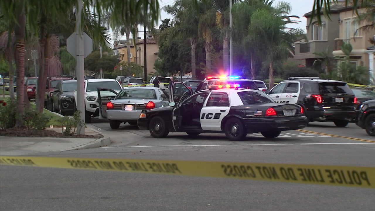 Huntington Beach police officers fatally shot a man and arrested a woman after a chase of a stolen vehicle ended with a foot pursuit Thursday, officials said.