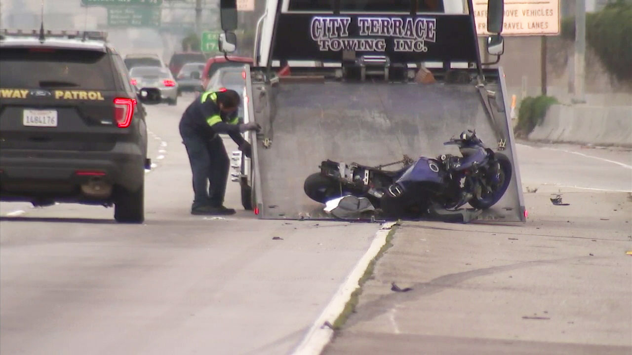 A photo shows crews towing away a motorcycle involved in a fatal crash on the 110 Freeway in South L.A. on Sunday, Oct. 14, 2018.