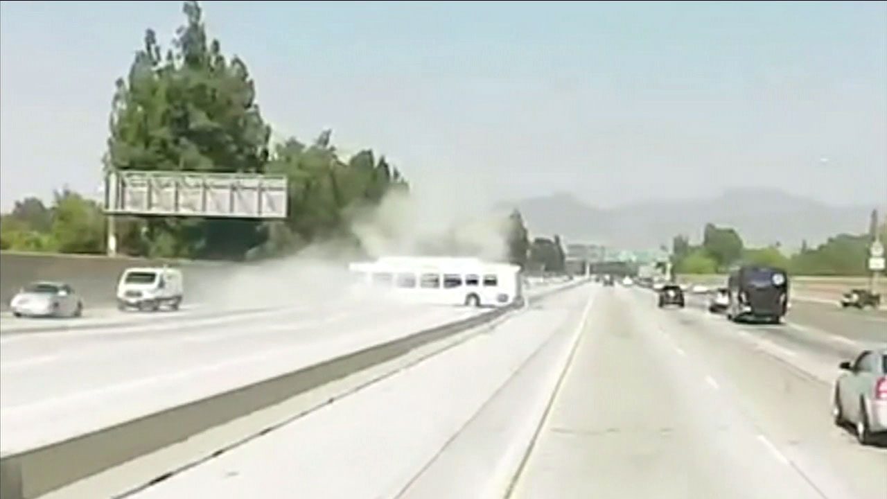 Exclusive video shows a bus spinning out of control on the 405 Freeway and smashing through the center divider, creating a massive jam and sending dozens to the hospital.