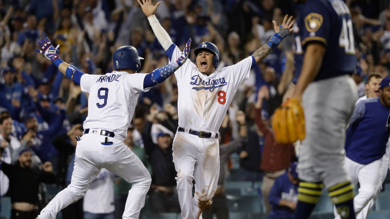 L.A. Dodgers Manny Machado reacts after scoring on a Cody Bellinger walk-off hit during the 13th inning of Game 4 of the National League Championship Series on Oct. 16, 2018.