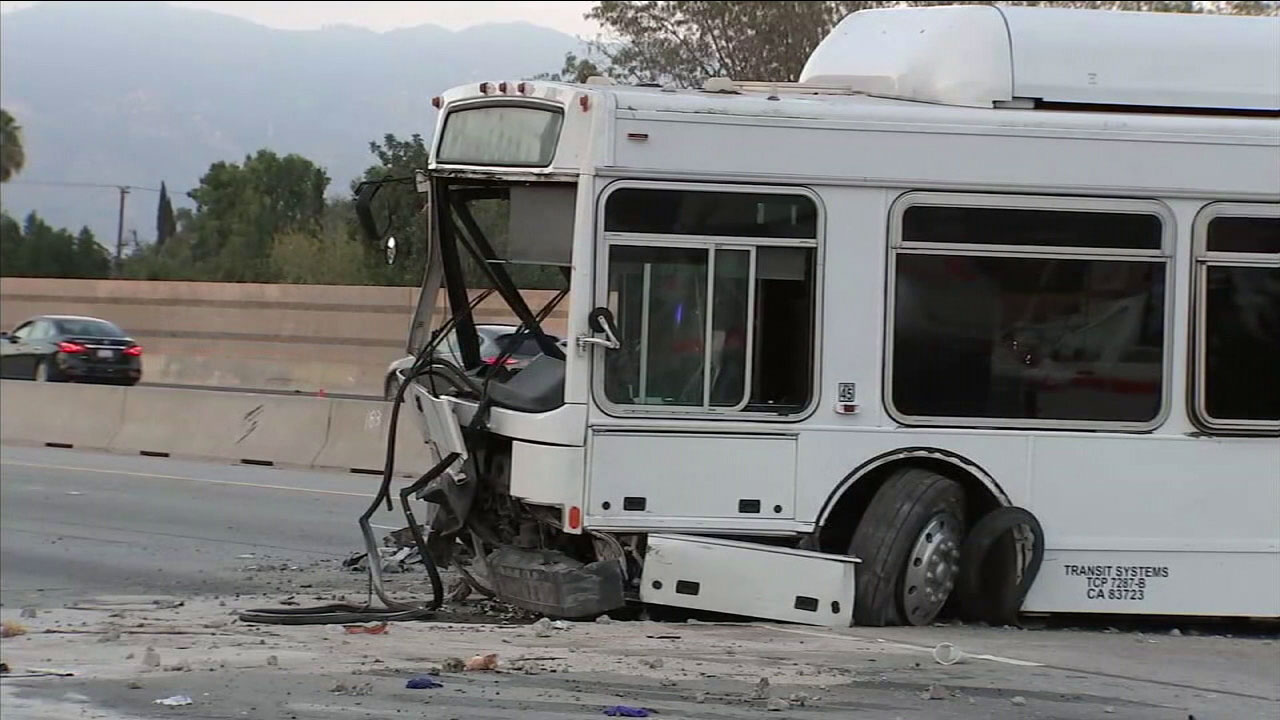 The wreckage of a bus crash on the 405 Freeway in North Hills is shown in a photo.