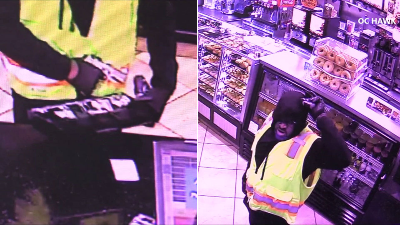 A suspect is seen robbing a donut shop in South Los Angeles on Wednesday, Oct. 17, 2018.