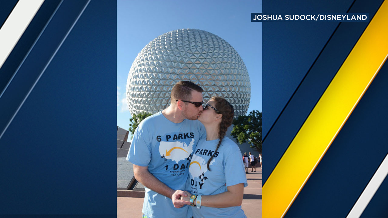 Clark and Heather Ensminger share a kiss in front of Spaceship Earth in Epcot at Walt Disney World in Lake Buena Vista, Fla. on Oct. 17, 2018.