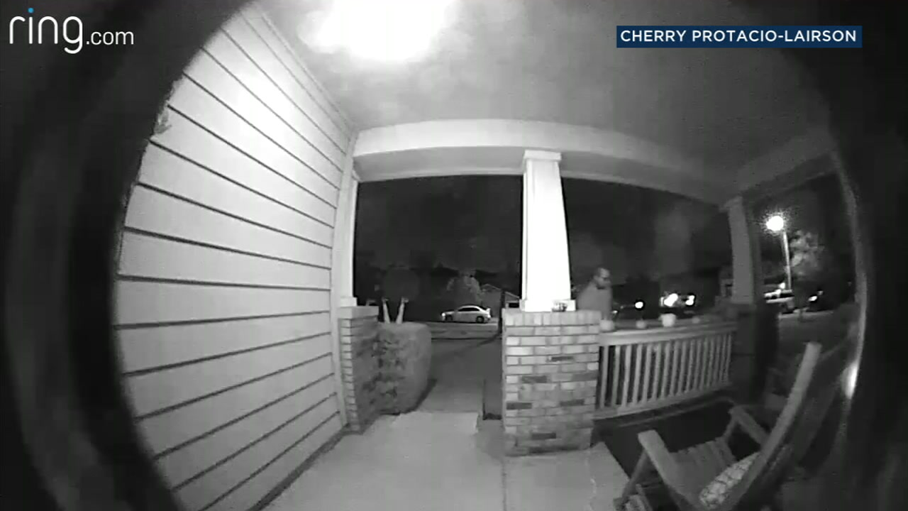 An unidentified suspect is seen on video taking Halloween decorations from the front porch of a familys home in Upland.