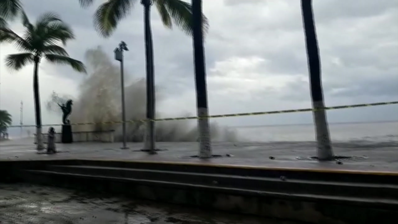 Waves crash against the short and up past an area in Mexico as Hurricane Willa closed in.