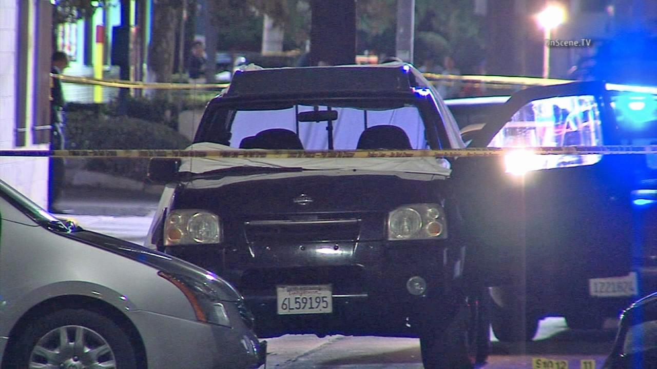 A stray bullet from a Canoga Park gang shooting left a man who had just gotten off work dead.
