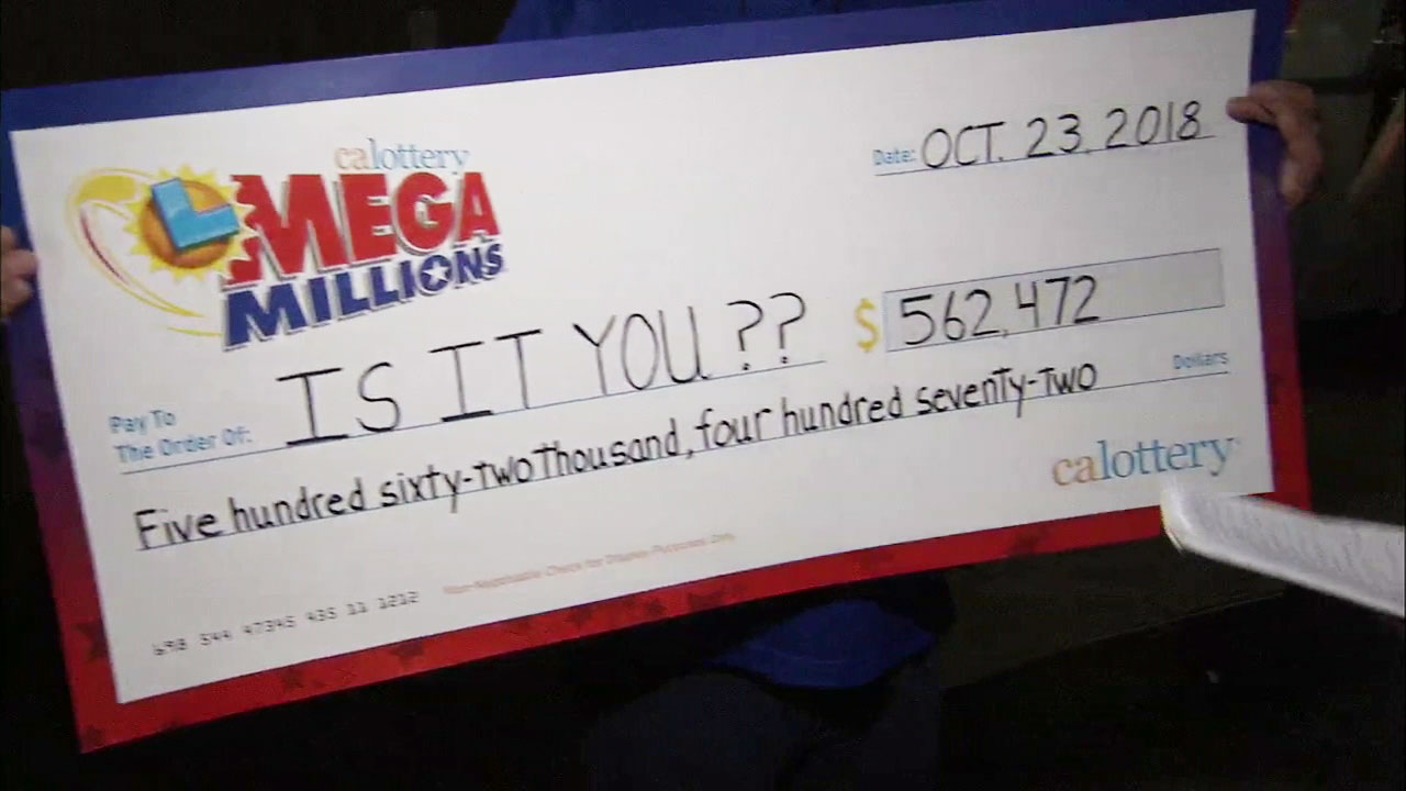 A giant check is held up for the lucky winner who purchased a Mega Millions ticket in Chatworth that matched five of six numbers with the winning jackpot ticket.