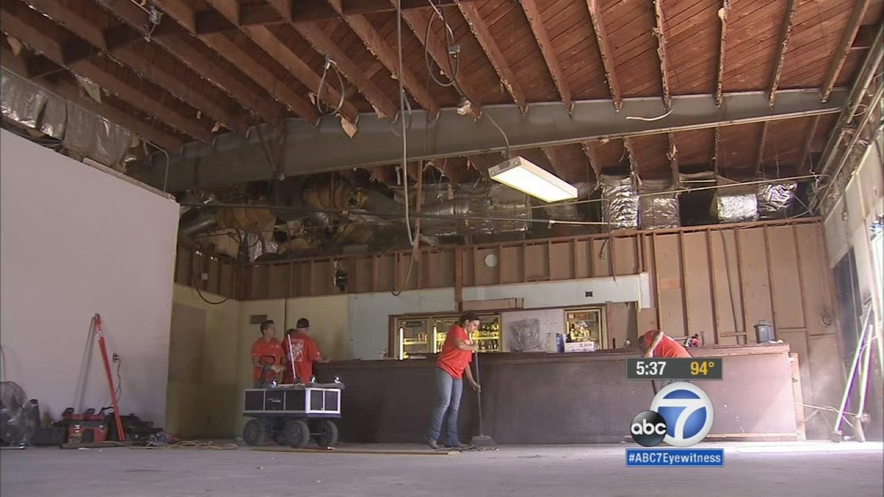 Volunteers from the Fontana Home Depot store work to renovate areas in the Veterans of Foreign Wars Post building in Rancho Cucamonga.