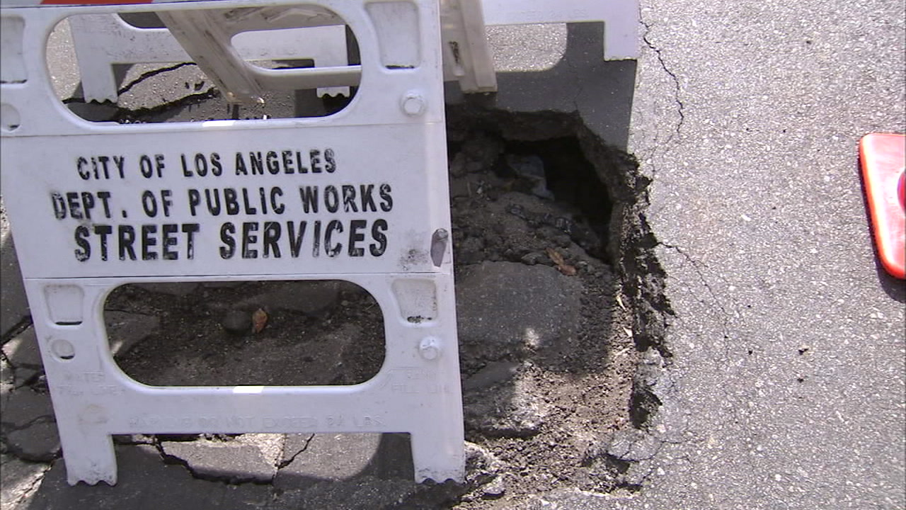 A pothole is shown in a photo.