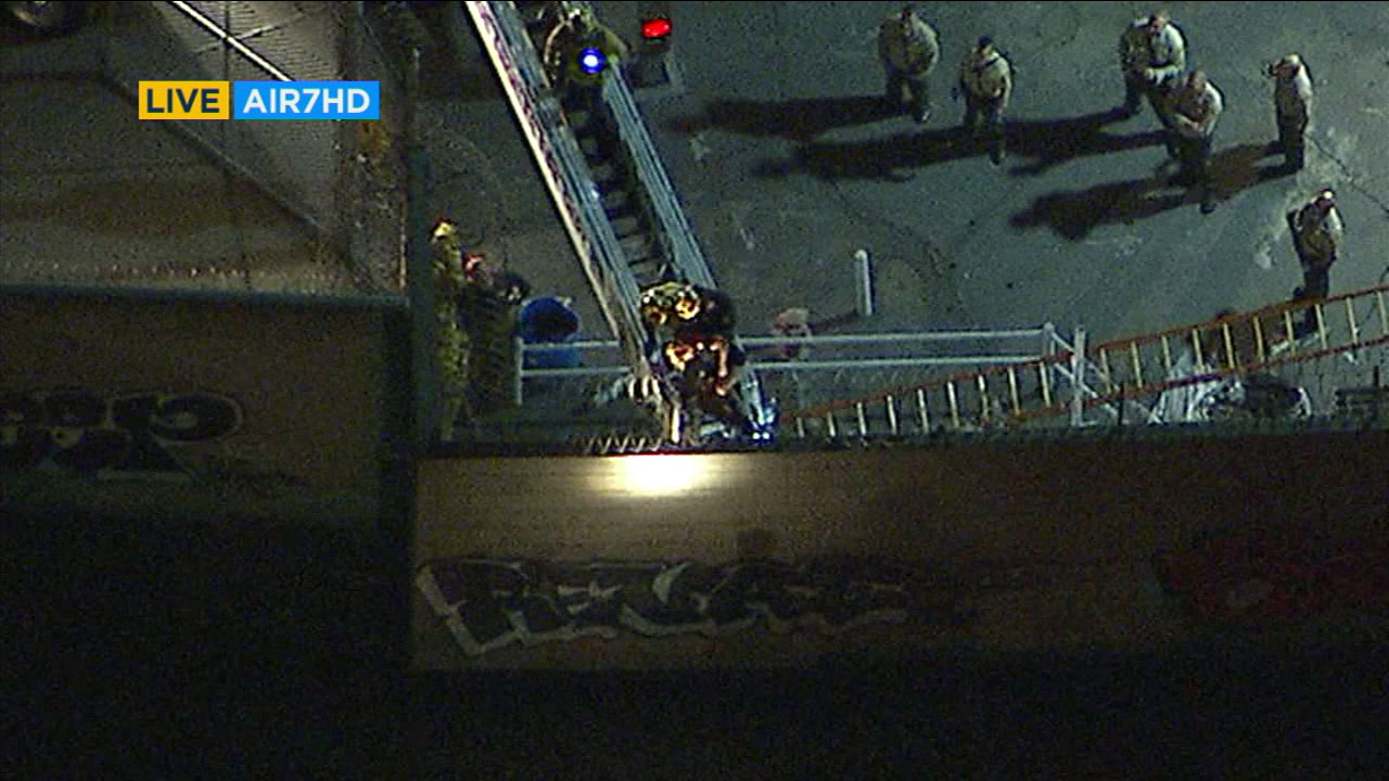 Firefighters attempted to rescue a person caught in barbed wire outside of Mens Central Jail in Los Angeles Friday night after reports of an escaped inmate.