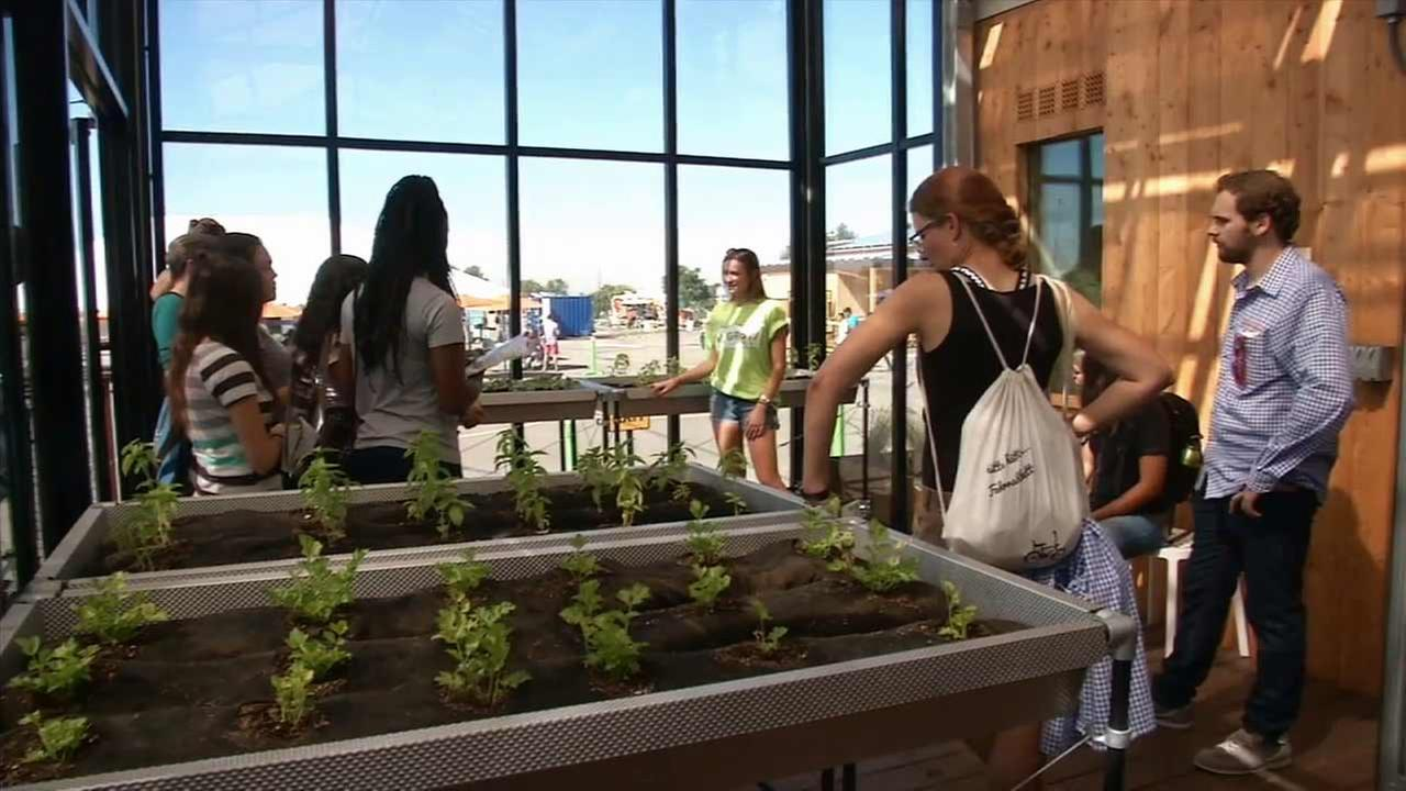 College students take part in the U.S. Department of Energy Solar Decathlon at the Orange County Great Park in Irvine.