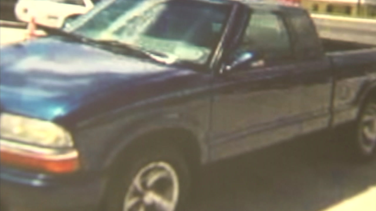 A blue Chevrolet pickup truck is shown in surveillance footage as authorities search for the driver involved in a fatal hit-and-run in San Gabriel.