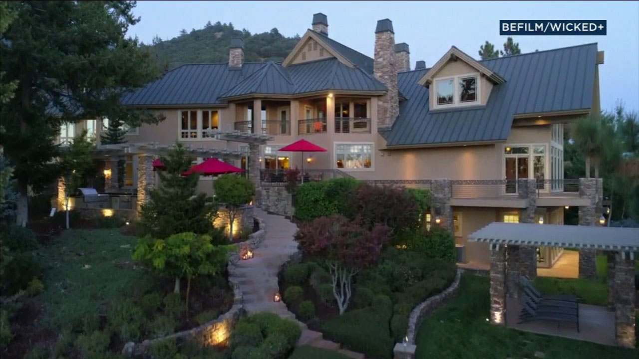 A massive mansion sitting on a mountain top in Oak Glen is shown in a video.