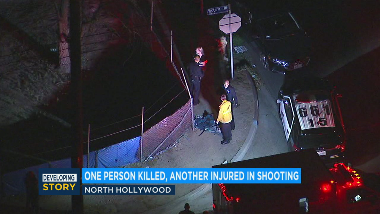 Authorities searched around a home in North Hollywood after two men were shot near the area.