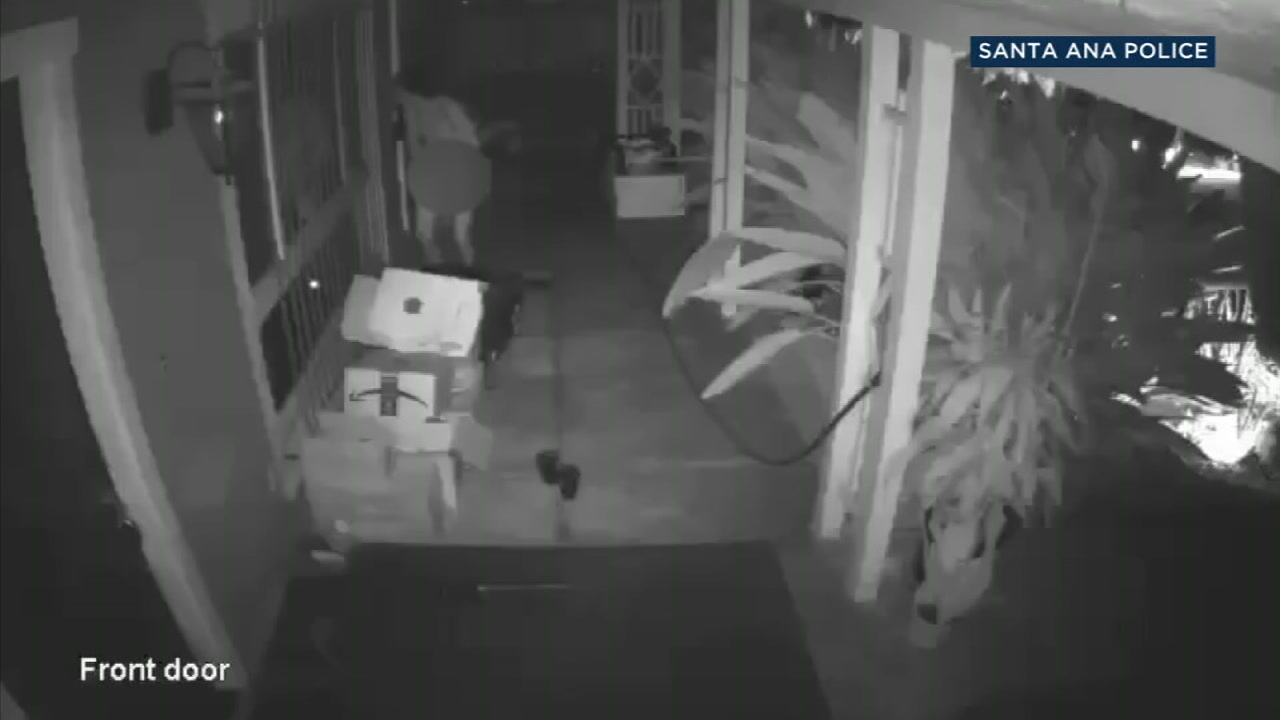 A naked man was captured on surveillance video and appears to be masturbating as he is looking through a window.