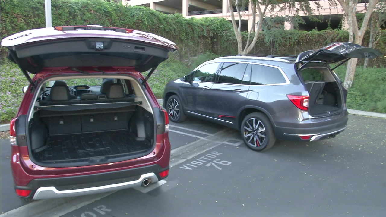 A Honda SUV and a Subaru SUV are shown in a photo.