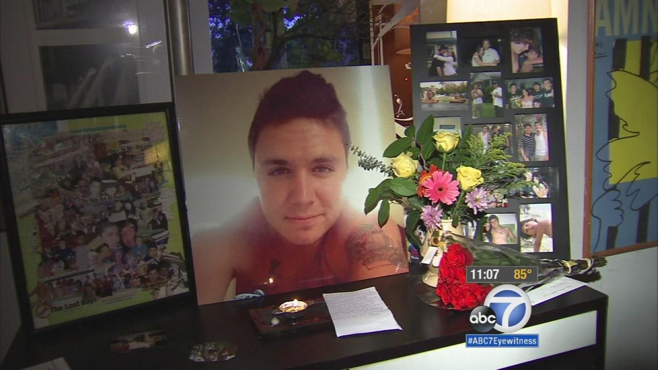 Christian Agudelos photo is on display in a makeshift memorial at his home on Monday, Oct. 12, 2015.