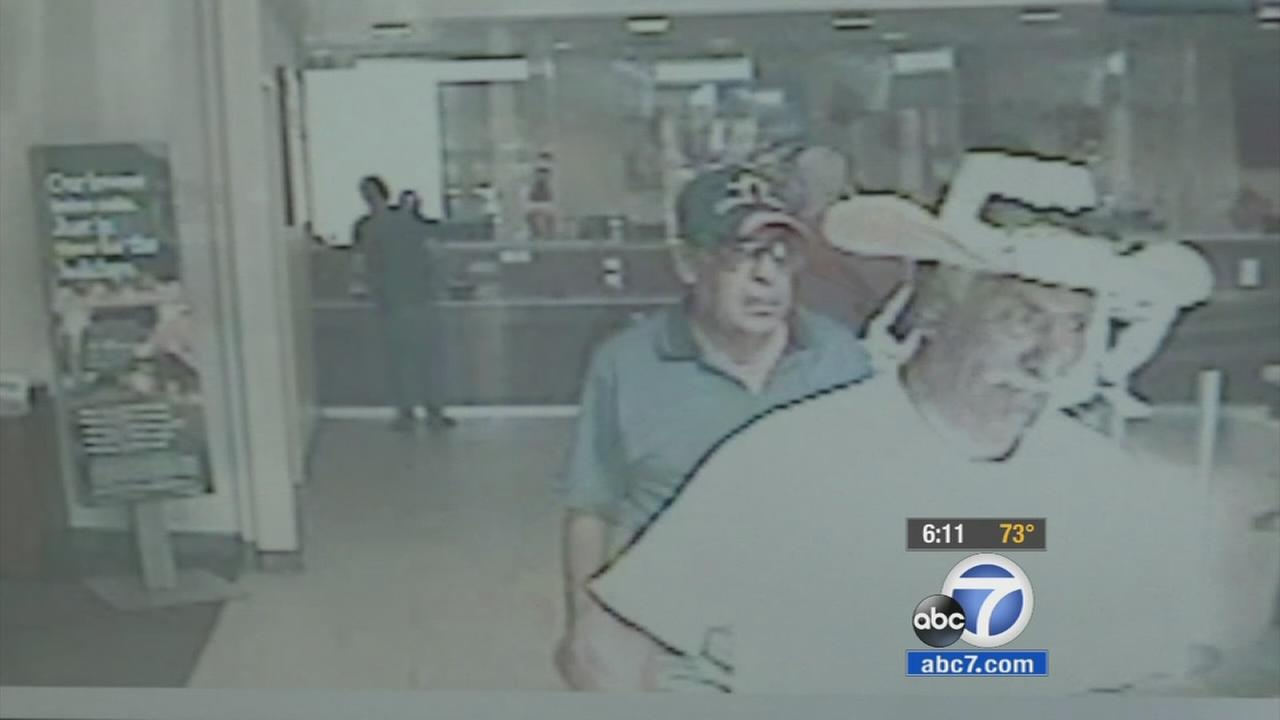 Surveillance footage shows an ATM robbery suspect in a baseball hat after robbing a man of his life savings.