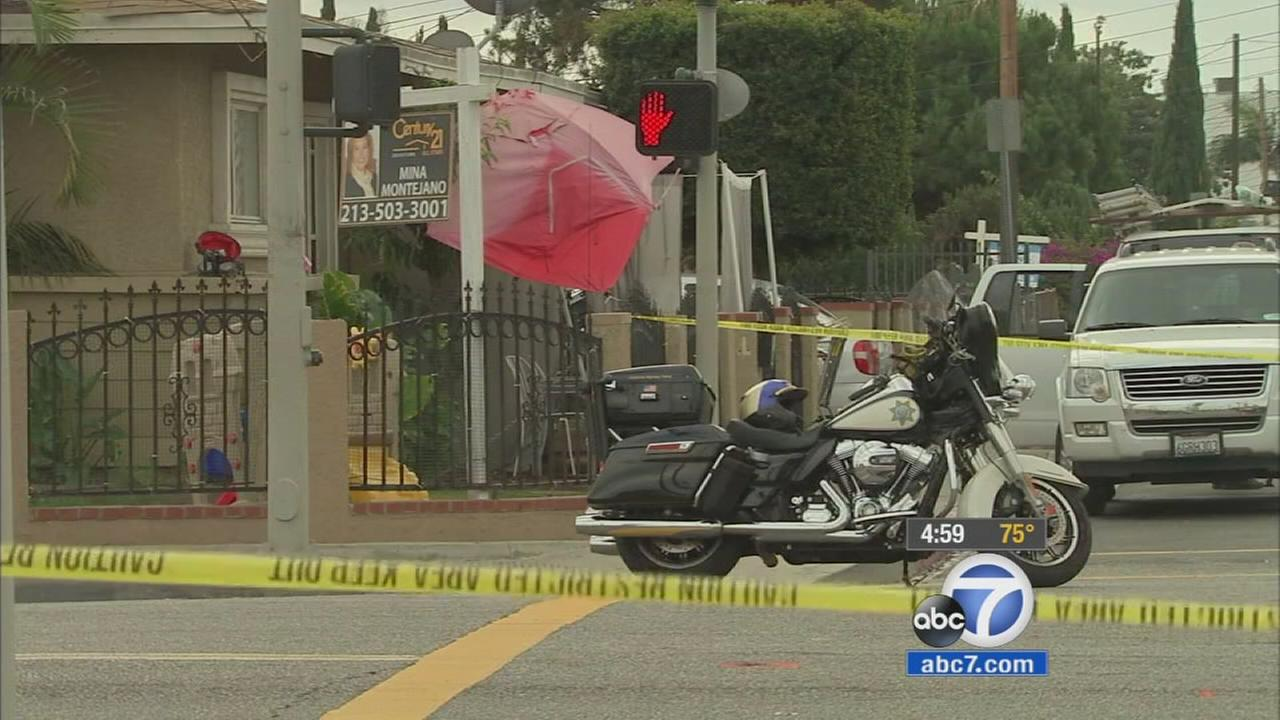 Authorities cordoned off the area of a fatal hit-and-run in Los Angeles on Lennox Boulevard on Sunday, Oct. 18, 2015.