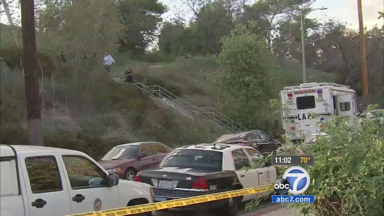 Authorities investigate a nature park in Montecito Heights after two young women were found dead in the area on Wednesday, Oct. 28, 2015.