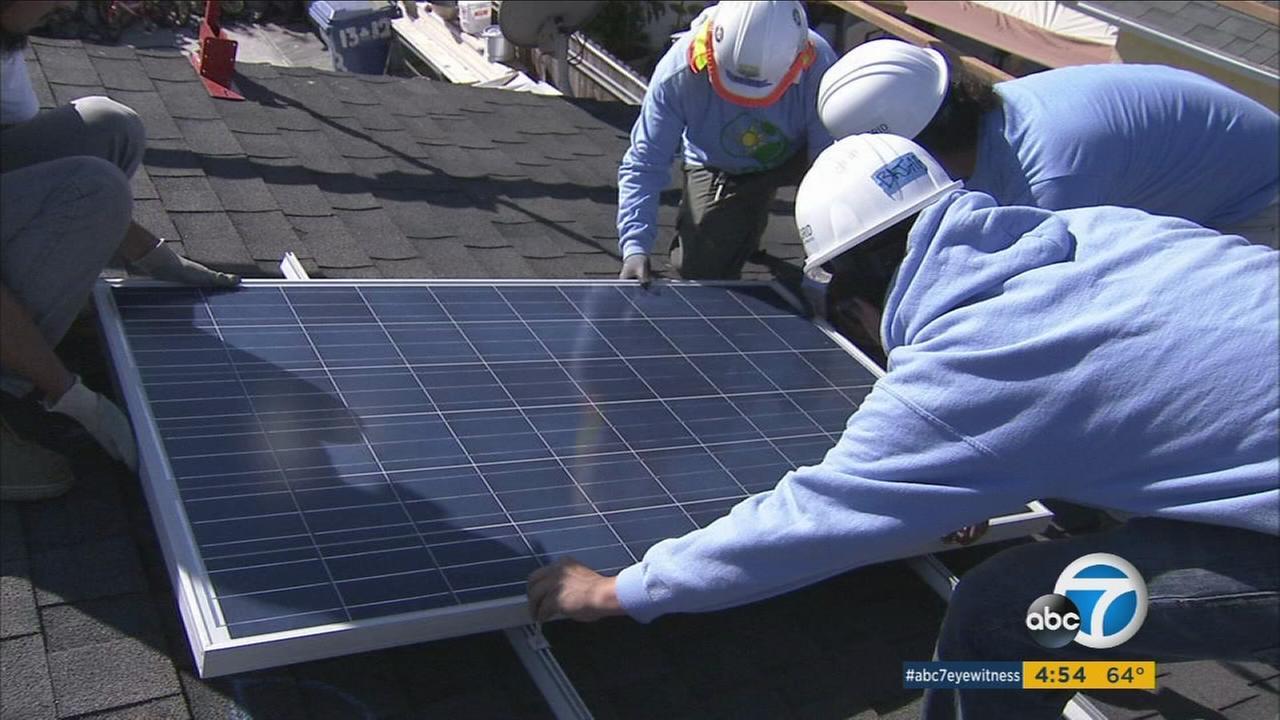 Watts family receives free solar panels through nonprofit