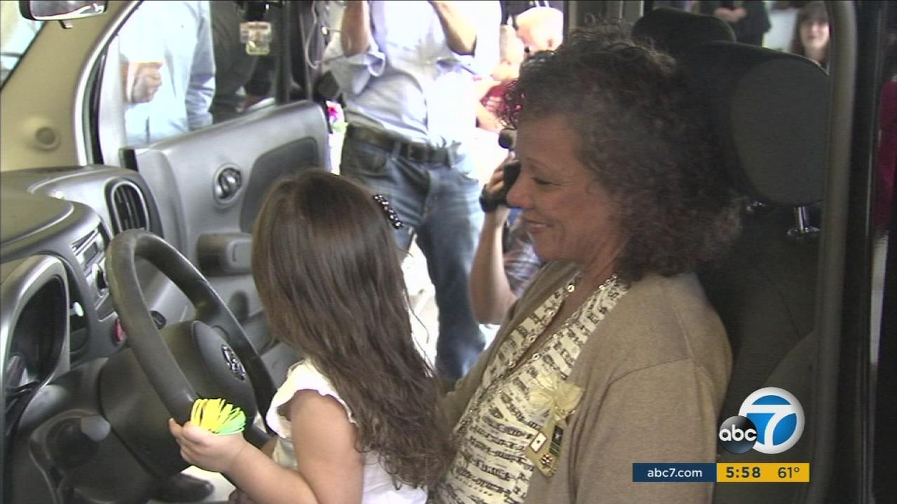 A Huntington Beach police officer who lost his own father in Vietnam surprised the mother of a soldier who died in Iraq by having her sons wrecked car restored.