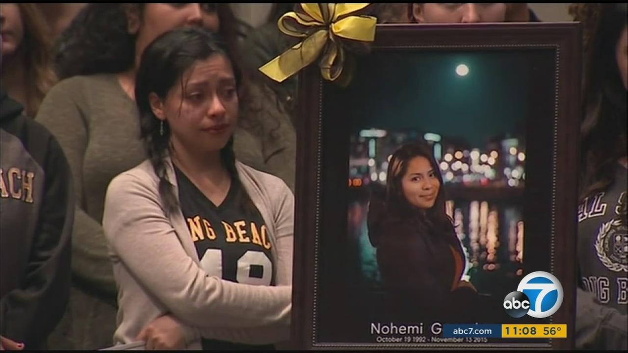 Students stood near a portrait of Nohemi Gonzalez during a vigil on Sunday, Nov. 15, 2015, held for her and others killed in the Paris terrorist attacks.