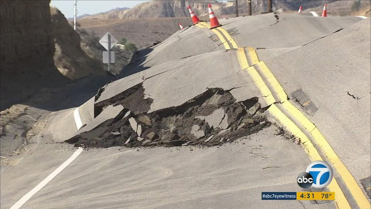 Vasquez Canyon Road has buckled and lifted 6 feet in some areas following a Santa Clarita landslide.