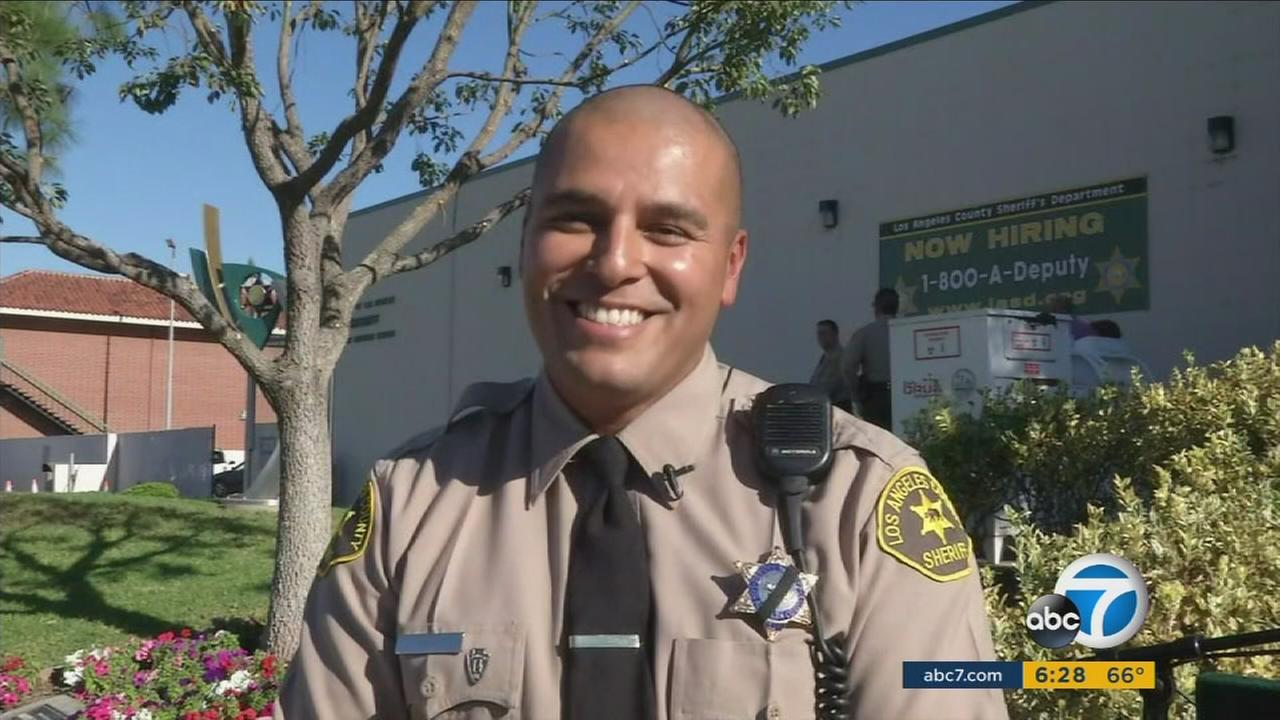 Los Angeles County Sheriffs Deputy Erik Nava, who helped save a 7-month-old boy on Monday, Nov. 16, 2015.
