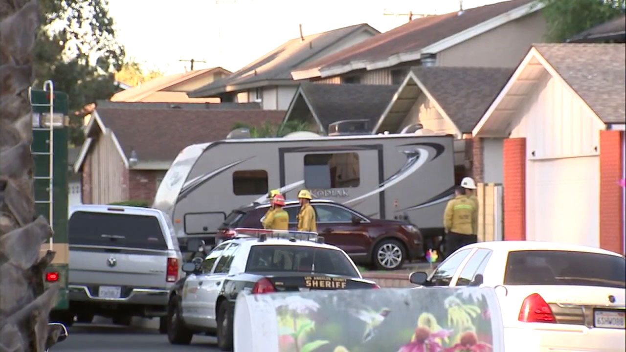Authorities surrounded a Diamond Bar home where two people were found dead inside following a fire.