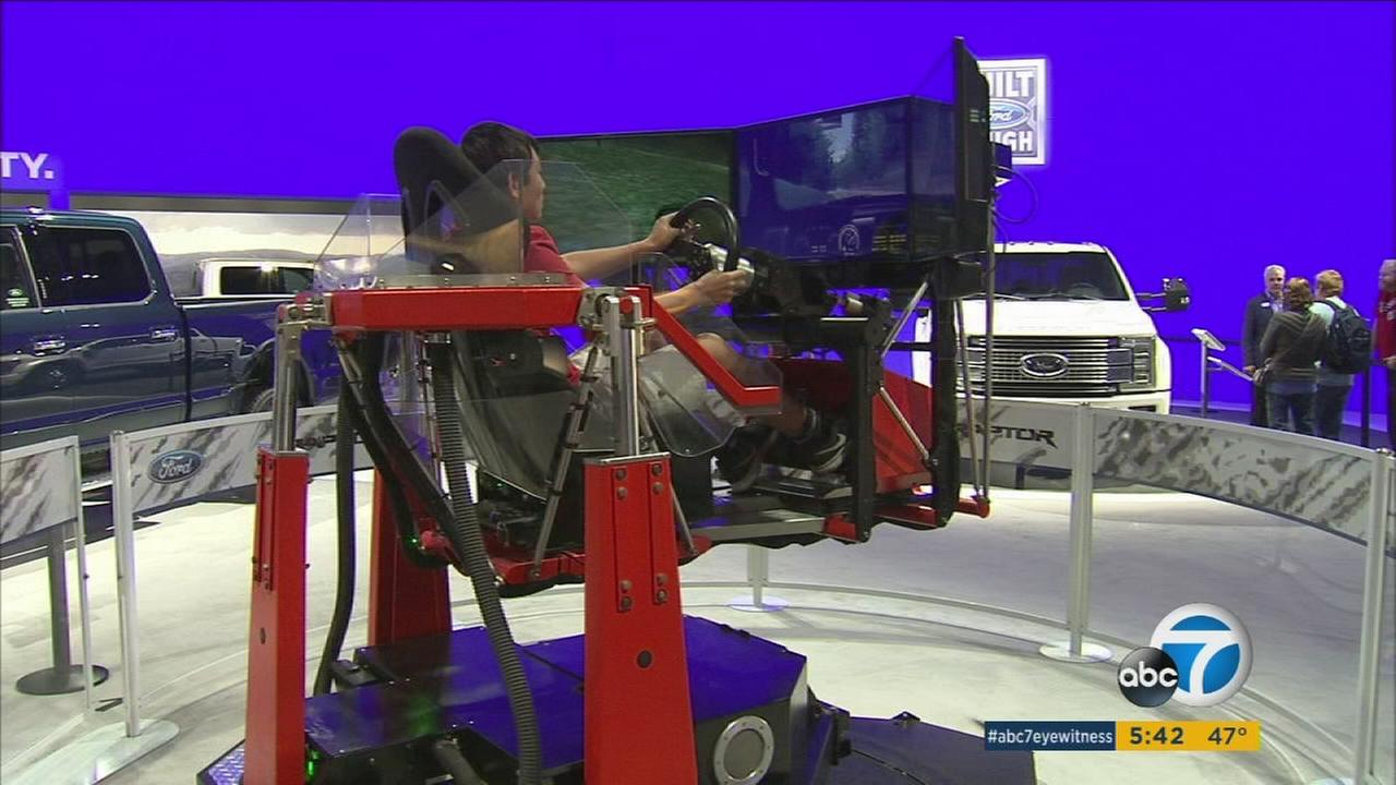 A man is shown inside of a new driving simulator at the Los Angeles Auto Show on Friday, Nov. 27, 2015.