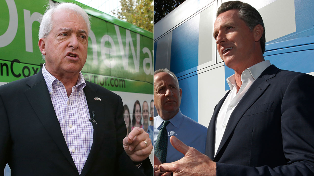 Republican gubernatorial candidate John Cox talks to reporters before beginning a statewide bus tour. Lt. Gov. Gavin Newsom, right, talks with reporters.