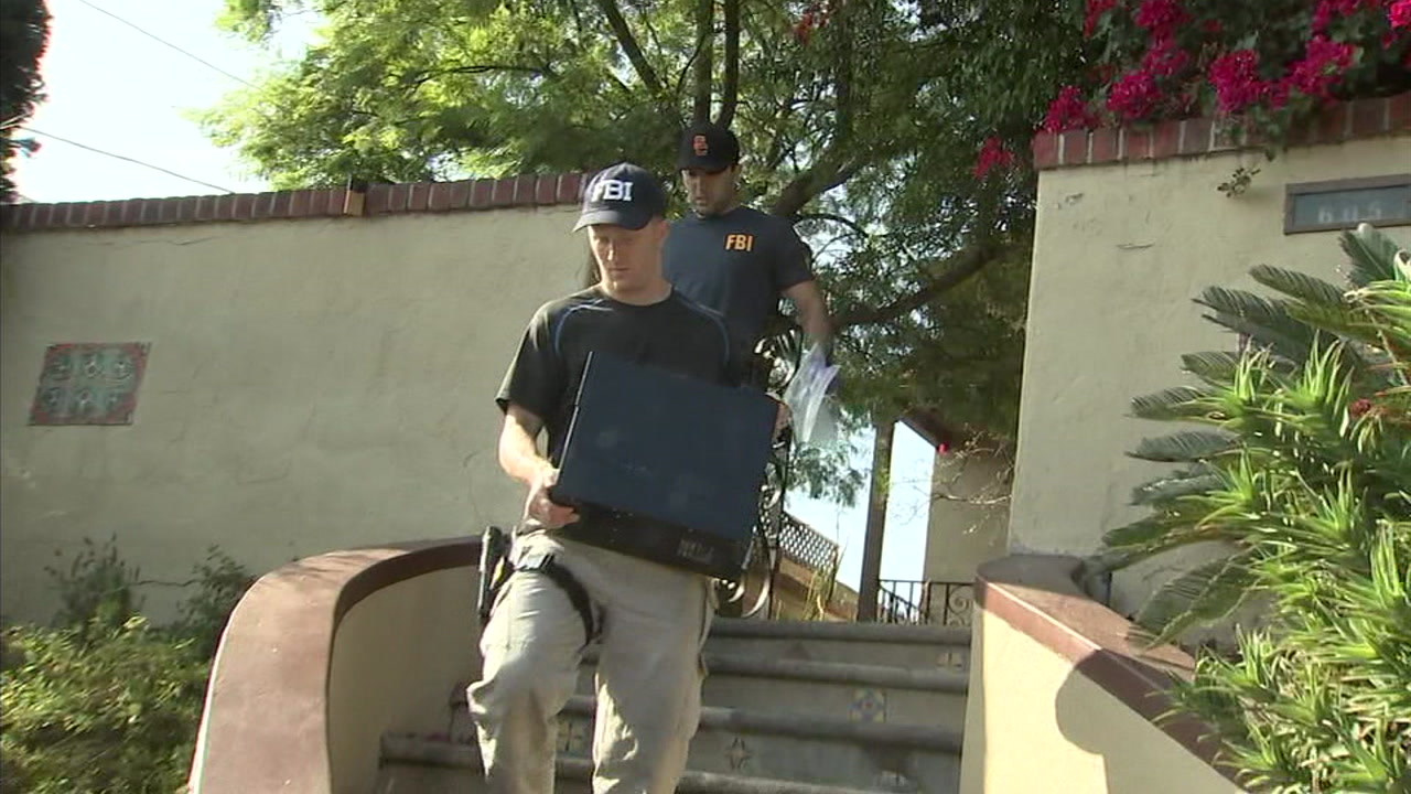FBI agents are shown walking out of Councilman Jose Huizars Boyle Heights home with items, including a computer, after raiding it Wednesday.