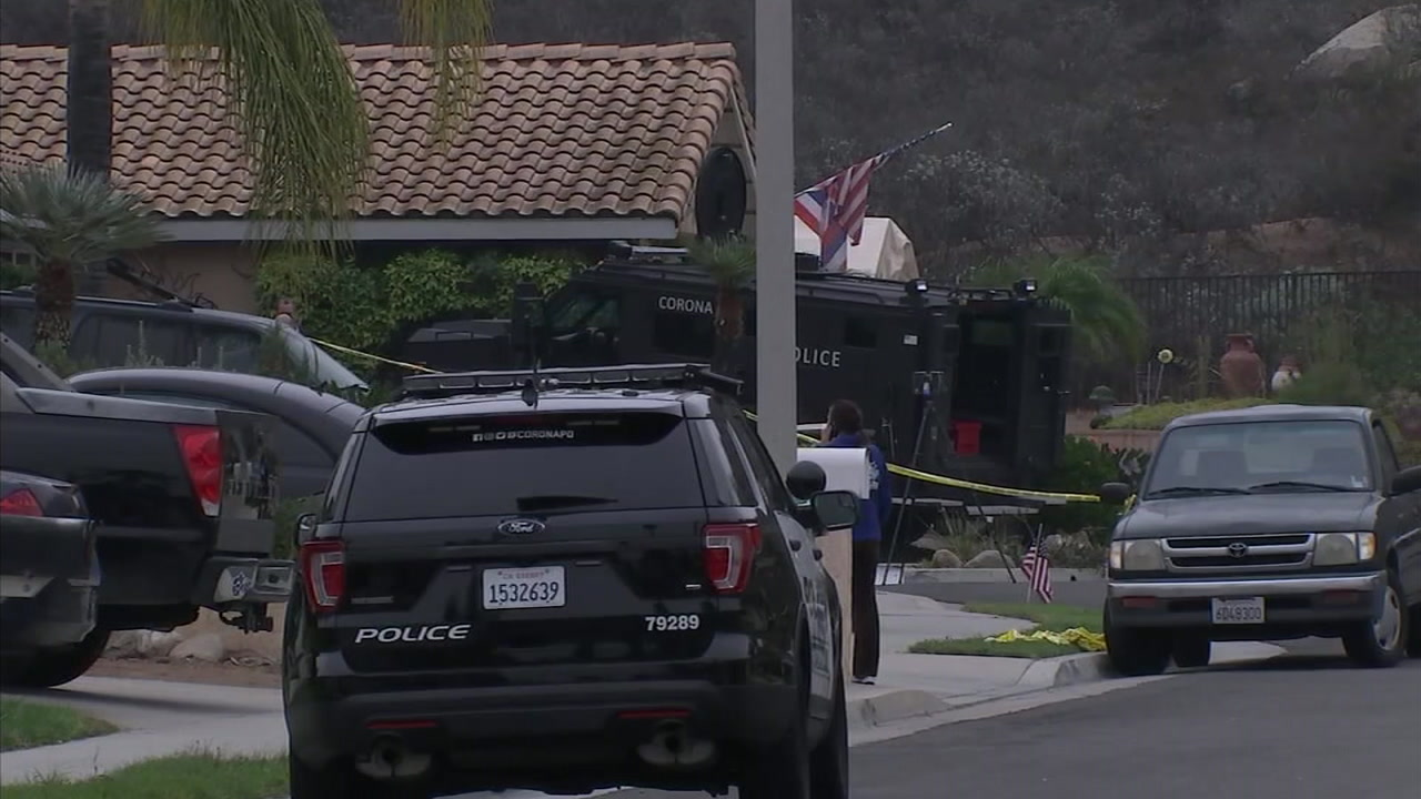 Police fatally shot a man in Corona after he allegedly critically wounded his wife and pointed a rifle at police.